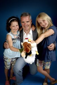 Hannah and Zoe Swerdlick from the Webkinz Webcast with their dad, Dave